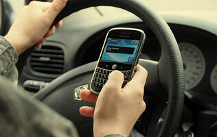 Drivers in the UK must surrender their mobile phones after an accident