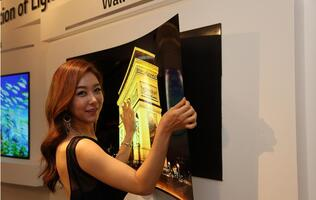 LG unveils 0.97mm press-on wallpaper OLED TV