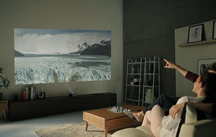 The LG Minibeam PH450U is a battery-powered ultra-short-throw projector for tight spaces