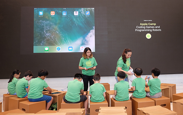 Learning to code at the Apple Camp for children