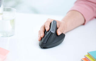 The Logitech MX Vertical Mouse is an ergonomic mouse that reduces arm strain