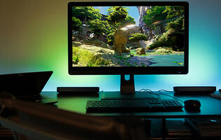 The Philips Hue Play light bar attaches to your monitor for some cool ambient lighting